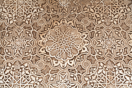 islamic pattern: Polychromed lacework stucco in the Alhambra of Granada, Spain