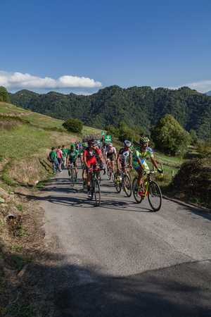 ASTURIAS, SPAIN. September 07th 2015. A small group of cyclists climbing to Ermita del Alba in the last meters of the 16th stage of