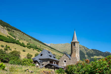 exterior view of the Montgarri high mountain refuge in summer, with the Pyrenees mountains of the Aran Valley in the background, Lleida, Spain Foto de archivo