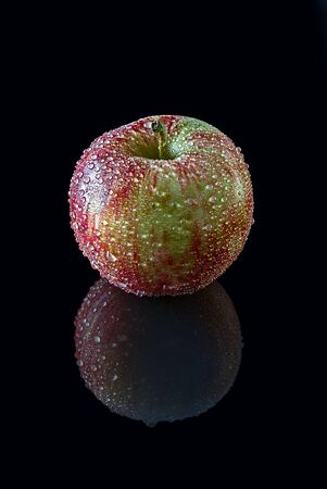 red apple in black background