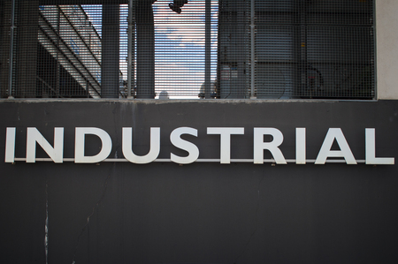 building feature: The industrial word in a wall of a industry building
