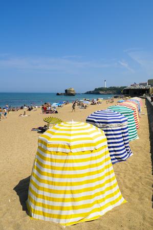 sun bathers: A summer day in Biarritz beach, France Stock Photo