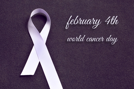 Lavender colored ribbon, symbolizing awareness for all cancers, with text: February 4th, World Cancer Day.