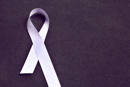 Lavender colored ribbon, symbolizing awareness for all cancers. February 4th, world cancer day.