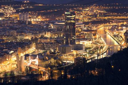 salve: BILBAO, SPAIN, JANUARY 30, 2016: View of the illuminated city of Bilbao, with Nervion river, Salve bridge, San Mames football stadium, Iberdrola tower and Guggenheim museum. Editorial