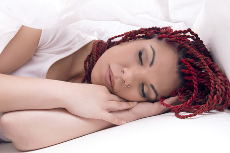 neutral: Modern woman sleeping in bed over white sheet, neutral. Stock Photo