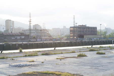 watercourse: Old and abandoned industrial buildings on the peninsula of zorrozaurre, between the Nervion river and the watercourse of Deusto, in the city of Bilbao, Basque Country, Spain.