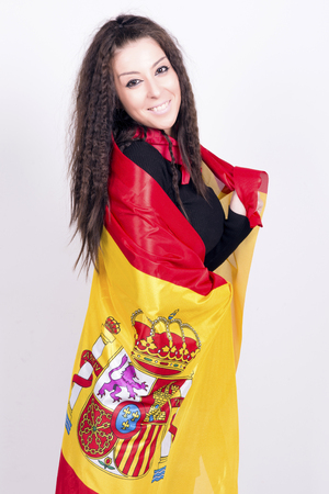 actual: Woman playing with a spanish flag, wrapped in. She is a Spain team supporter!. Actual flag, no add ons.