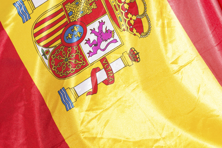 actual: Close Up of an actual spanish flag, used, with wrinkles.