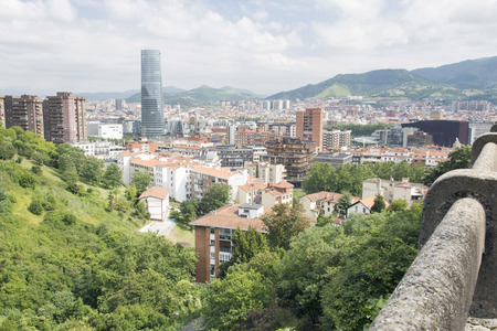 hillsides: View of the city of Bilbao in the afternoon. District of Deusto in first term, taken from one of the hillsides surrounding the city.
