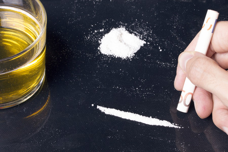 Drug abuse!: Cocaine addiction, combined with alcohol. Health danger. Stok Fotoğraf