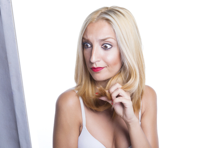 split lip: Woman and her blonde hair. Worried about her split ends. Over a white background. Isolated.