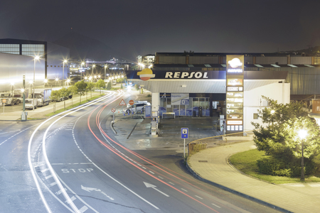 is based: ERANDIO, BISCAY, BASQUE COUNTRY, SPAIN - OCTOBER 1, 2016: A company Repsol gas station at night. Repsol gas and fuel is a multinational based in Spain. It is the 15th largest fuel company in the world refining. Editorial
