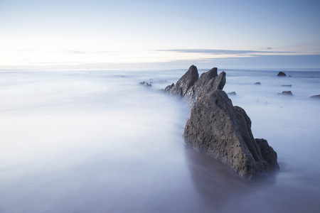 Serene seascape in Barrika beach, Biscay, Basque Country, Spain. Long exposure shot.