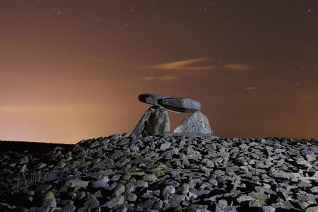 Dolmen named Chabola de la Hechicera, in Elvillar, Alava, Spain. Long exposure at night.