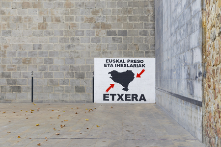 ELORRIO, SPAIN - OCTOBER 17, 2017: Basque pelota court, with a big painting about basque prisoners, asking for prisoner approach to the Basque Country. Éditoriale