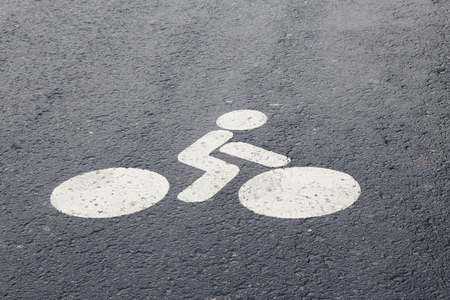 Bicycle or bike sign on a road, painted in the asphalt. Copy Space for Text Banque d'images
