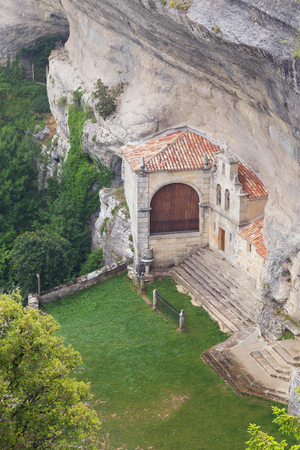 Ancient hermitage and cave of Saint Bernabe, in Ojo Guarena natural park, in Burgos, Castile and Leon, Spain. Stock Photo
