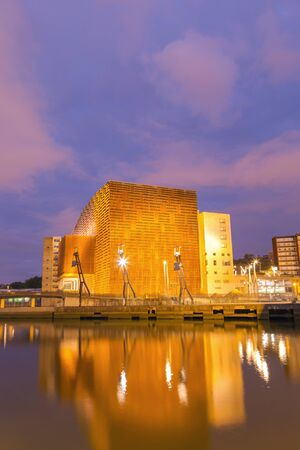 BILBAO, SPAIN - JULY 21, 2017: Euskalduna conference centre and concert hall, at sunset, near the Nervion river in the centre of the city of Bilbao, Basque Country, Spain. Long exposure shot. Editorial