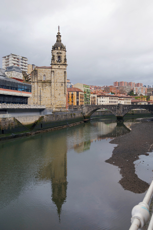 San Anton church and the Ribera market, in the old town of Bilbao, Basque Country, Spain. On a cloudy day.