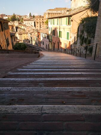 way up stairs between colorful houses