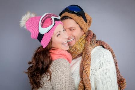 wintersport couple enjoying colder season isolated photo