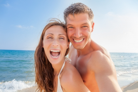 happy laughing smiling beach couple photo