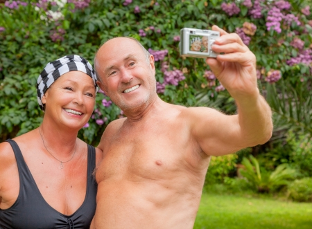 matures: older matures taking self portrait with camera