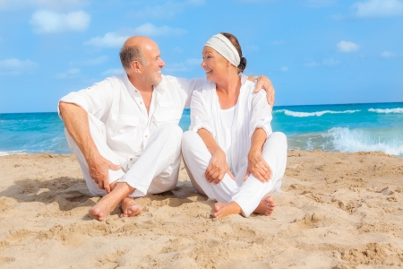 older couple travelling on the beach photo