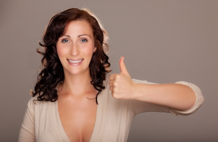 thumbs up female expressive woman Stock Photo - 19588315
