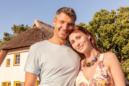 lovely couple beyound house outdoor photo