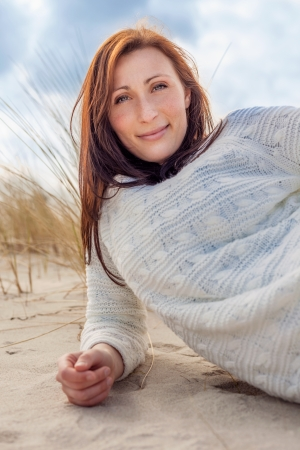 relaxing female on coast smiling