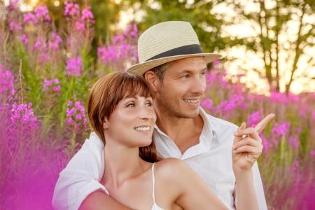 lover couple in flower field Banco de Imagens