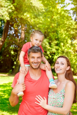 happy family outdoors in park photo