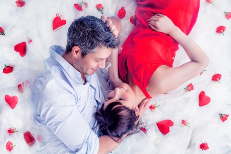 day bed: lying lovers couple in romantic scene