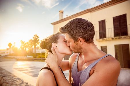 beach coast kissing romantic scene boy and girl photo