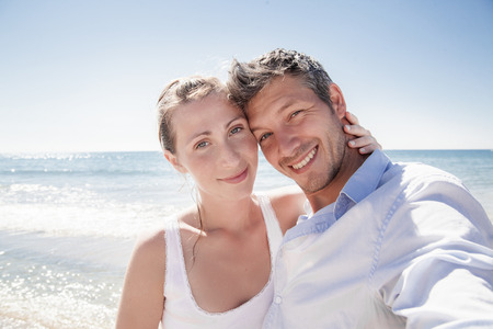 charming smiling couple with selfportrait photo