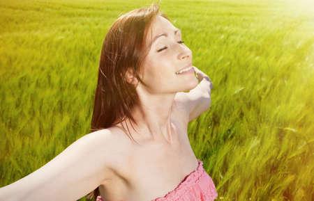 deep breathing ypunger female on sunny day