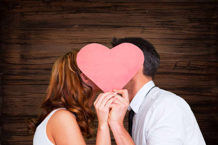 cute kissing couple on wooden background Stock Photo - 26055614