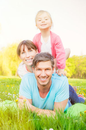 healthy family: cute smiling funny three family members
