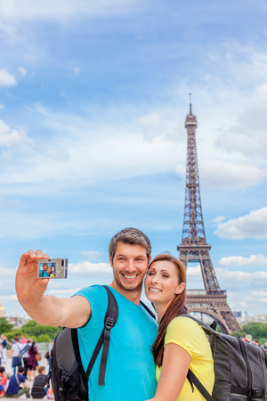 tourist making picture visiting city of love photo