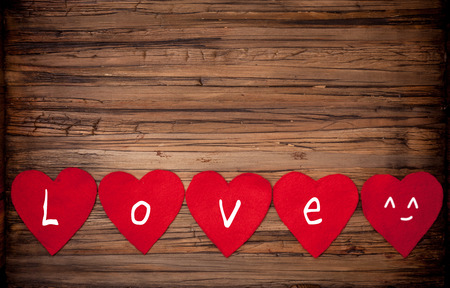 wedding backdrop: love letters on wooden background
