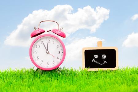 spring clock copyspace on chalkboard photo