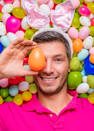 funny easter portrait of male with bunny ears photo