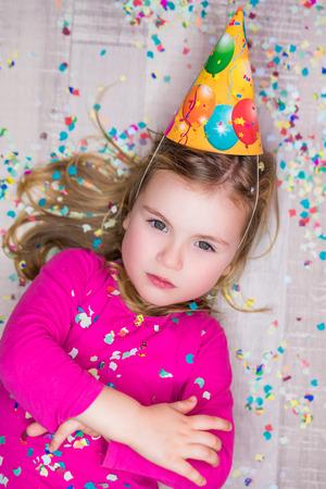 teenagers having fun: cute confetti carnival party  girl