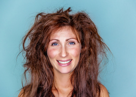 smiling happy woman with crazy hair Stock Photo - 26527726