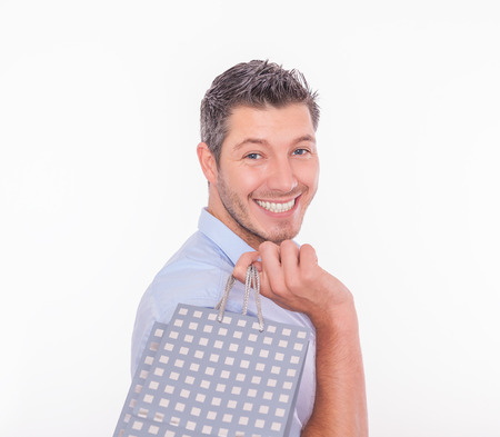 smiling modern shopping male with bag photo
