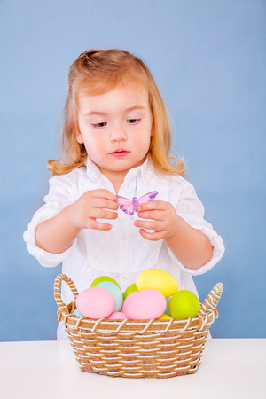 cute little easter girl with eggs photo