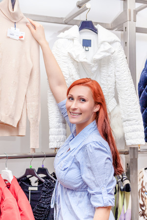 red haired female shopping indoors photo