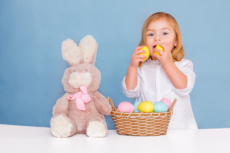 sweet little easter girl with eggs photo